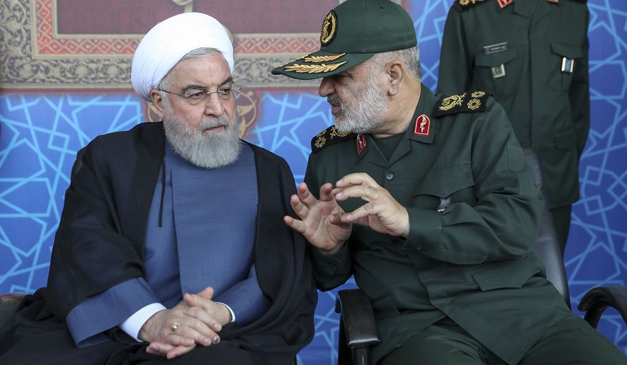 Iranian President Hassan Rouhani (left) spoke Sunday with the chief of the Islamic Revolutionary Guard Corps, Maj. Gen. Hossein Salami. Mr. Rouhani said his country should lead regional security in the strategic Persian Gulf and warned against the presence of foreign forces, as the country's nuclear deal with world powers collapses and the U.S. deployed more troops to boost security for its Arab allies. (Associated Press)