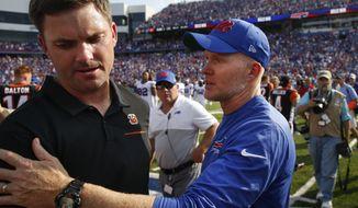 Buffalo Bills head coach Sean McDermott, right, talks to Cincinnati Bengals head coach Zac Taylor after an NFL football game Sunday, Sept. 22, 2019, in Orchard Park, N.Y. The Bills won 21-17. (AP Photo/John Munson)