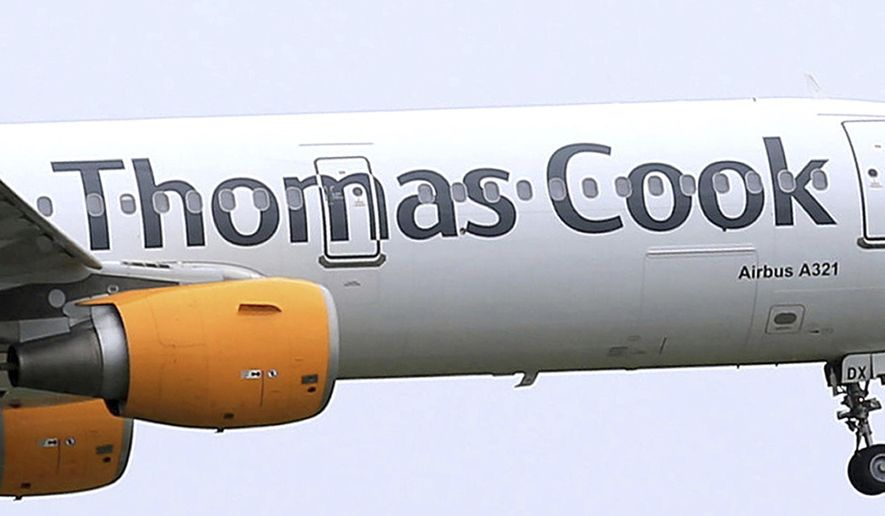In this May 19, 2016, file photo, a Thomas Cook plane takes off in England. More than 600,000 vacationers who booked through tour operator Thomas Cook were on edge Sunday, wondering if they will be able to get home, as one of the world's oldest and biggest travel companies teetered on the edge of collapse. The debt-laden company, which confirmed Friday it was seeking 200 million pounds ($250 million) in funding to avoid going bust, was in talks with shareholders and creditors to stave off failure. (Tim Goode/PA via AP, file)