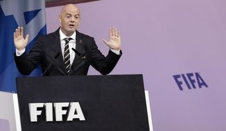 """FILE  - In this Wednesday, June 5, 2019 file photo FIFA President Gianni Infantino delivers his speech during the 69th FIFA congress in Paris. FIFA President Gianni Infantino said Sunday, Sept. 22, 2019 soccer's governing body has been """"assured"""" that Iran will lift its 40-year ban and allow women to attend a World Cup qualifying game next month.(AP Photo/Alessandra Tarantino, File)"""