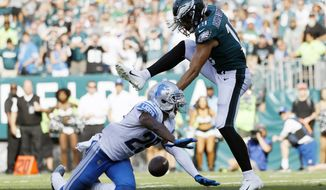 Philadelphia Eagles' J.J. Arcega-Whiteside, right, cannot catch a pass against Detroit Lions' Rashaan Melvin during the second half of an NFL football game, Sunday, Sept. 22, 2019, in Philadelphia. Detroit won 27-24. (AP Photo/Michael Perez)