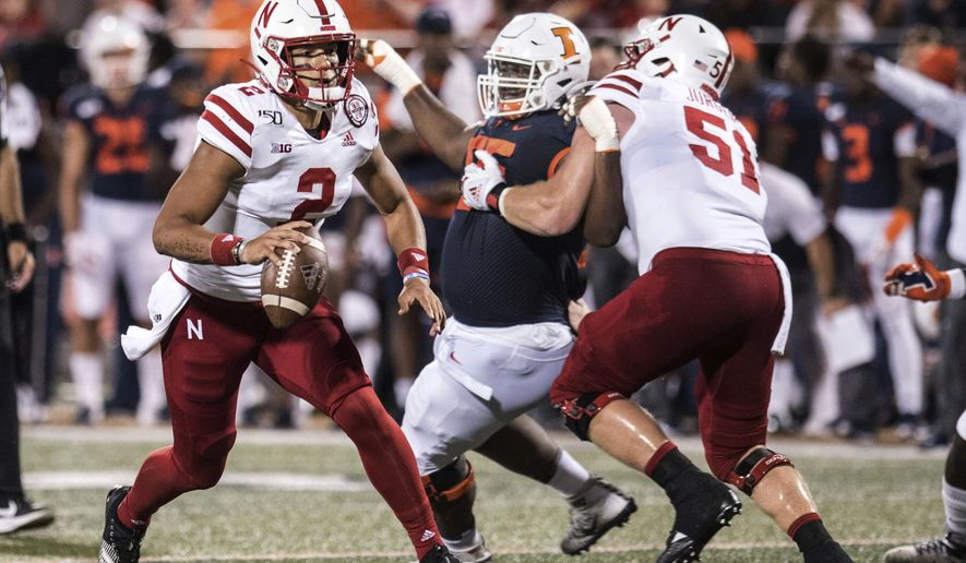 Nebraska's Adrian Martinez (2) is pressured by Illinois' Jamai Milan (55) in the first half of an NCAA college football game, Saturday, Sept. 21, 2019, in Champaign, Ill. (AP Photo/Holly Hart)
