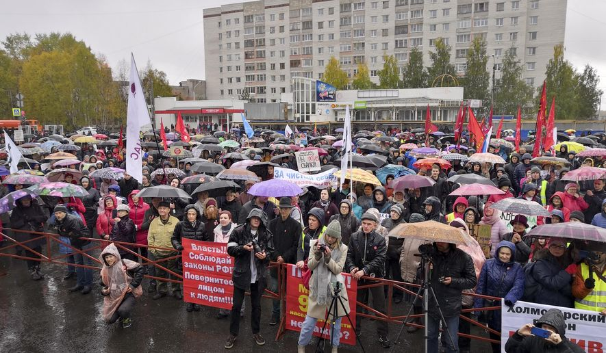 People gather during a rally against plans for the waste plant in a pristine Russian forest has gained national prominence, in Arkhangelsk, Russia, Sunday, Sept. 22, 2019. Several thousand people have taken to the streets across northwest Russia to protest a controversial plan to build a major waste plant there. (AP Photo/Ilya Leonyuk)