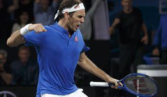 Team Europe's Roger Federer, celebrates after winning against Team world's John Isner at the Laver Cup tennis event in Geneva, Switzerland, Sunday, Sept. 22, 2019. (Salvatore Di Nolfi/Keystone via AP)