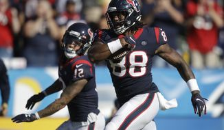 Houston Texans tight end Jordan Akins (88) scores against the Los Angeles Chargers during the second half of an NFL football game Sunday, Sept. 22, 2019, in Carson, Calif. (AP Photo/Marcio Jose Sanchez)