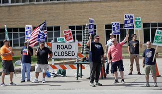 General Motors workers pickets outside the General Motors Fabrication Division, on Monday in Parma, Ohio. Some 49,000 members of the United Auto Workers' union have been on strike against General Motors since Sept. 16. (ASSOCIATED PRESS)
