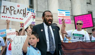 Rep. Al Green joins impeachment activists with a youth-led group, By The People, to call for Congress to remove President Trump from office, outside the Rayburn House Office Building on Capitol Hill on Monday. (Associated Press)
