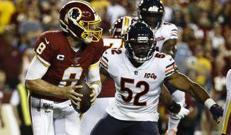 Washington Redskins quarterback Case Keenum (8) is pursued by Chicago Bears linebacker Khalil Mack (52) during the first half of an NFL football game Monday, Sept. 23, 2019, in Landover, Md. (AP Photo/Patrick Semansky)