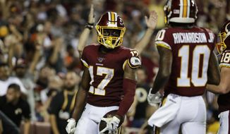 Washington Redskins wide receiver Terry McLaurin (17) celebrates his touchdown with Paul Richardson (10) during the second half of an NFL football game against the Chicago Bears, Monday, Sept. 23, 2019, in Landover, Md. (AP Photo/Julio Cortez) ** FILE **