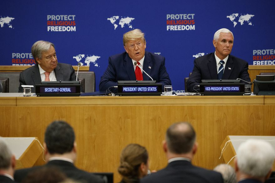 United Nations Secretary General Antonio Guterres, left, and Vice President Mike Pence, right, listen as President Donald Trump speaks at an event on religious freedom during the United Nations General Assembly, Monday, Sept. 23, 2019, in New York. (AP Photo/Evan Vucci)