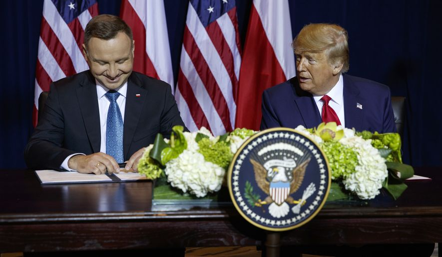 President Donald Trump and Polish President Andrzej Duda sign a joint defense declaration agreement at the InterContinental Barclay hotel during the United Nations General Assembly, Monday, Sept. 23, 2019, in New York. (AP Photo/Evan Vucci)