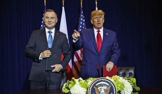 President Donald Trump and Polish President Andrzej Duda talk after signing a joint defense declaration agreement at the InterContinental Barclay hotel during the United Nations General Assembly, Monday, Sept. 23, 2019, in New York. (AP Photo/Evan Vucci)
