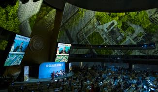 A panel addresses attendees at the Climate Action Summit 2019 at the 74th session of the United Nations General Assembly, at U.N. headquarters, Monday, Sept. 23, 2019. (AP Photo/Craig Ruttle)