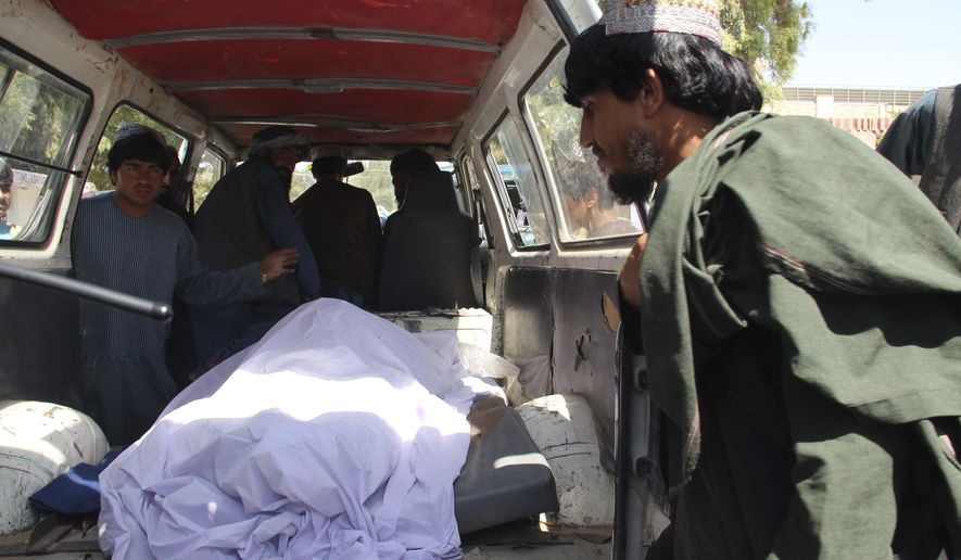 Afghans transport the body of a woman who was killed during a raid conducted by Afghan special forces, in the southern Helmand province, Monday, Sept. 23, 2019. An Afghan official said Monday that at least 40 civilians have been killed during an Afghan special forces raid and airstrikes conducted against of Taliban in southern Helmand province. (AP Photo/Abdul Hadi)