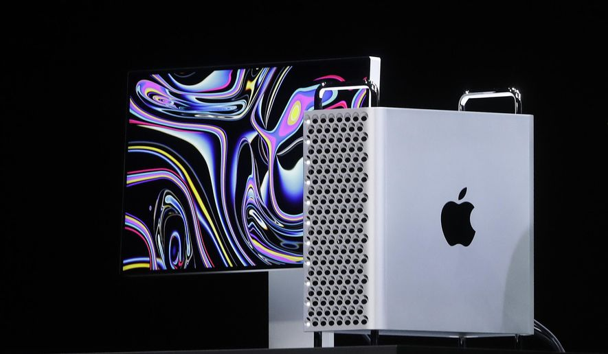 FILE - In this June 3, 2019, file photo, Apple CEO Tim Cook speaks about the Mac Pro at the Apple Worldwide Developers Conference in San Jose, Calif. Apple announced Monday, Sept. 23, it will continue manufacturing its Mac Pro computers in Texas after the Trump administration approved its request to waive tariffs on certain parts from China. (AP Photo/Jeff Chiu, File)