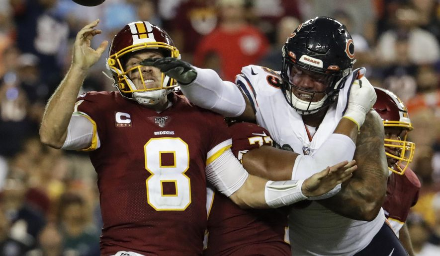 Chicago Bears outside linebacker Khalil Mack (52) hits Washington Redskins quarterback Case Keenum (8) to cause a fumble during the first half of an NFL football game Monday, Sept. 23, 2019, in Landover, Md. (AP Photo/Julio Cortez)  **FILE**