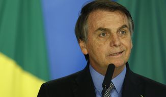 Brazil's President Jair Bolsonaro speaks at a ceremony to kickoff the Economic Freedom Project, at the Planalto Palace, in Brasilia, Brazil, Friday, Sept. 20, 2019. This is Bolsonaro's first public event since his Sept. 8th surgery. (AP Photo/Eraldo Peres)