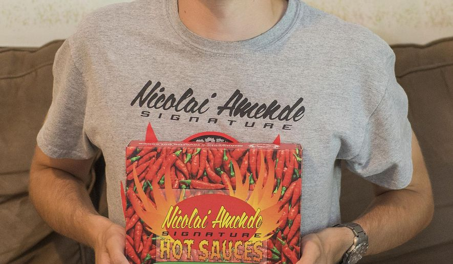 Nicolai Amende started Nicolai Amende Signature Hot Sauces seven years ago. His hot sauces can be found at Hilltop Meat Market, Wooden Spoon, Blue Sky Mercantile, Welsh Heritage Farms, Cheese and Pie Mongers in St. Peter and the Yellow Barn. (Jackson Forderer/The Free Press via AP)