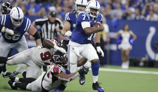 Indianapolis Colts quarterback Jacoby Brissett (7) runs out of the tackle of Atlanta Falcons defensive tackle Jack Crawford (95) during the second half of an NFL football game against the Atlanta Falcons, Sunday, Sept. 22, 2019, in Indianapolis. (AP Photo/Michael Conroy)