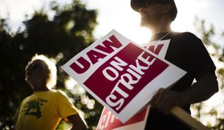 In this Sept. 16, 2019, file photo, union members picket outside a General Motors facility in Langhorne, Pa. The strike against GM by United Auto Workers entered its second week Monday, Sept. 23, with progress reported in negotiations but no clear end in sight. Bargainers met all weekend and returned to talks Monday morning as the strike entered its eighth day. (AP Photo/Matt Rourke, File)