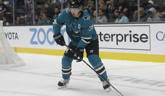 San Jose Sharks center Logan Couture (39) looks to pass the puck against the Vegas Golden Knights during the first period of an NHL preseason hockey game in San Jose, Calif., Saturday, Sept. 21, 2019. (AP Photo/Jeff Chiu)