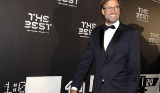 Liverpool manager Juergen Klopp arrives to attend the Best FIFA soccer awards, in Milan's La Scala theater, northern Italy, Monday, Sept. 23, 2019. Netherlands defender Virgil van Dijk is up against five-time winners Cristiano Ronaldo and Lionel Messi for the FIFA best player award and United States forward Megan Rapinoe is the favorite for the women's award. (AP Photo/Luca Bruno)