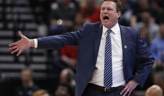 FILE - In this March 21, 2019, file photo, Kansas head coach Bill Self reacts in the first half during a first round men's college basketball game against Northeastern in the NCAA Tournament in Salt Lake City. A person familiar with the situation says the University of Kansas received a notice of allegations from the NCAA on Monday, Sept. 23, 2019, that alleges significant violations within its storied men's basketball program.The person spoke to The Associated Press on condition of anonymity because neither the NCAA nor the school had announced the notice, which was first reported by Yahoo Sports. That initial report, citing unnamed sources, said the notice included three Level 1 violations tied primarily to recruiting, lack of institutional control and a responsibility charge leveled against Hall of Fame coach Self. (AP Photo/Jeff Swinger, File)