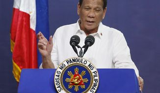 FILE - In this Aug. 27, 2019, file photo, Philippine President Rodrigo Duterte gestures as he addresses the topic of land reform in Manila, Philippines. Duterte's presidential spokesman Salvador Panelo says the Philippines is suspending negotiations and signing of loans and grants with 18 countries that backed a U.N. human rights resolution calling for an inquiry into human rights conditions. (AP Photo/Bullit Marquez, File)