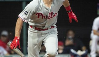 Philadelphia Phillies' J.T. Realmuto watches his RBI-double off Cleveland Indians starting pitcher Adam Plutko during the third inning of a baseball game in Cleveland, Sunday, Sept. 22, 2019. (AP Photo/Phil Long)