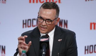 FILE - In this April 19, 2019, file photo, Detroit Red Wings general manager Steve Yzerman answers a question in Detroit. Yzerman is entering his first season in charge of a franchise plodding through a rebuilding project. (AP Photo/Carlos Osorio, File)