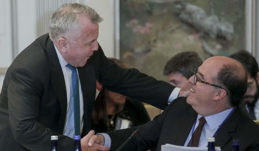 U.S. Deputy Secretary of State John Sullivan, left, and Julio Borges, an opposition leader in Venezuela, shake hands before a meeting organized by the OAS, to discuss sanctions on Venezuela, Monday Sept. 23, 2019, in New York. (AP Photo/Bebeto Matthews) ** FILE **