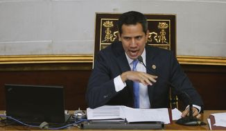 In this Sept. 17, 2019, file photo, Venezuelan opposition leader and self-proclaimed interim president of Venezuela Juan Guaido speaks during a weekly session at the National Assembly in Caracas, Venezuela. (AP Photo/Ariana Cubillos, File)