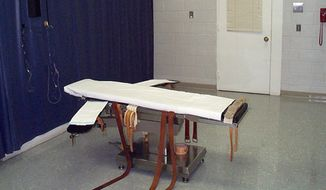 This undated file photo provided by the Virginia Department of Corrections shows the execution chamber at the Greensville Correctional Center in Jarratt, Va. Prison officials are unconstitutionally limiting public access to executions in Virginia by blocking witnesses from seeing certain steps in the process, four news organizations allege in a federal lawsuit filed Monday, Sept. 23, 2019. (Virginia Department of Corrections via AP)