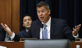 FILE - In this July 18, 2018, file photo, Rep. Sean Duffy, R-Wis., asks a question on Capitol Hill in Washington. As Duffy spends his final day as a member of Congress, the focus shifts to who else will run to succeed him in a rural Wisconsin district that's the heart of Trump country. Duffy's resignation Monday, Sept. 23, 2019, also clears the way for Gov. Tony Evers to announce when the special election will be to fill the seat. (AP Photo/Jacquelyn Martin, File)