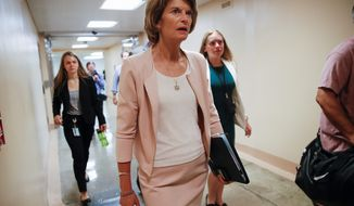 """There is a line here that I believe has been overstepped,"" Sen. Lisa Murkowski, Alaska Republican, said about rebuking President Trump and the national emergency funds. (Associated Press)"
