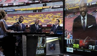 ESPN Monday Night Countdown broadcast team (left to right) Suzy Kolber, Steve Young, Randy Moss, Louis Riddick and Adam Schefter appear on set prior to an NFL football game between the Chicago Bears and Washington Redskins, Monday, Sept. 23, 2019, in Landover, Md. (AP Photo/Mark Tenally)