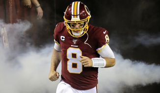 Washington Redskins quarterback Case Keenum runs onto the field prior to during an NFL football game against the Chicago Bears, Monday, Sept. 23, 2019, in Landover, Md. (AP Photo/Mark Tenally) **FILE**
