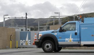 In this Feb. 1, 2019, file photo, a Pacific Gas & Electric truck drives past a PG&E entrance in Daly City, Calif. Thousands of people in Northern California woke up Tuesday, Sept. 24, 2019, without electricity after Pacific Gas & Electric cut power to try to prevent wildfires amid windy, dry and hot conditions. PG&E cut electrical service to 24,000 customers in three counties in the Sierra Nevada foothills Monday evening, saying power will remain off until weather conditions improve. The utility said it may restore service briefly on Tuesday before it cuts it Tuesday night. (AP Photo/Jeff Chiu, File) **FILE**
