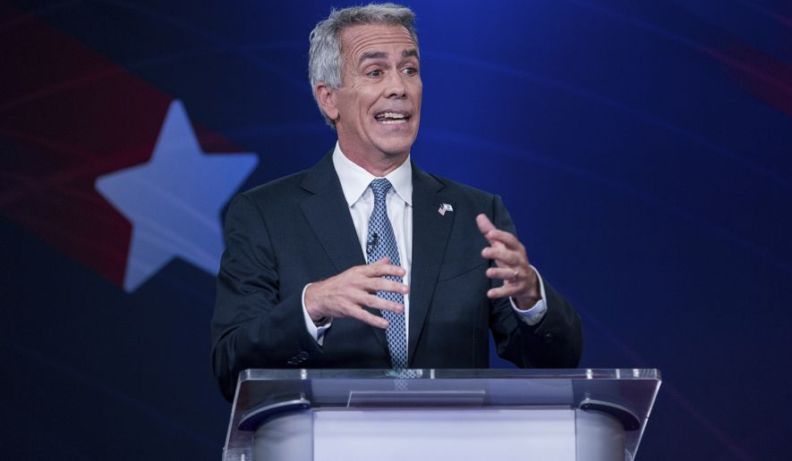 Republican presidential candidate and former U.S. Rep. Joe Walsh, R-Ill., speaks at a debate alongside former Massachusetts Gov. Bill Weld, hosted by Business Insider, Tuesday, Sept. 24, 2019, in New York. Weld and Walsh are competing to win the Republican nomination over President Donald Trump, who did not participate in the debate. (AP Photo/Julius Constantine Motal)