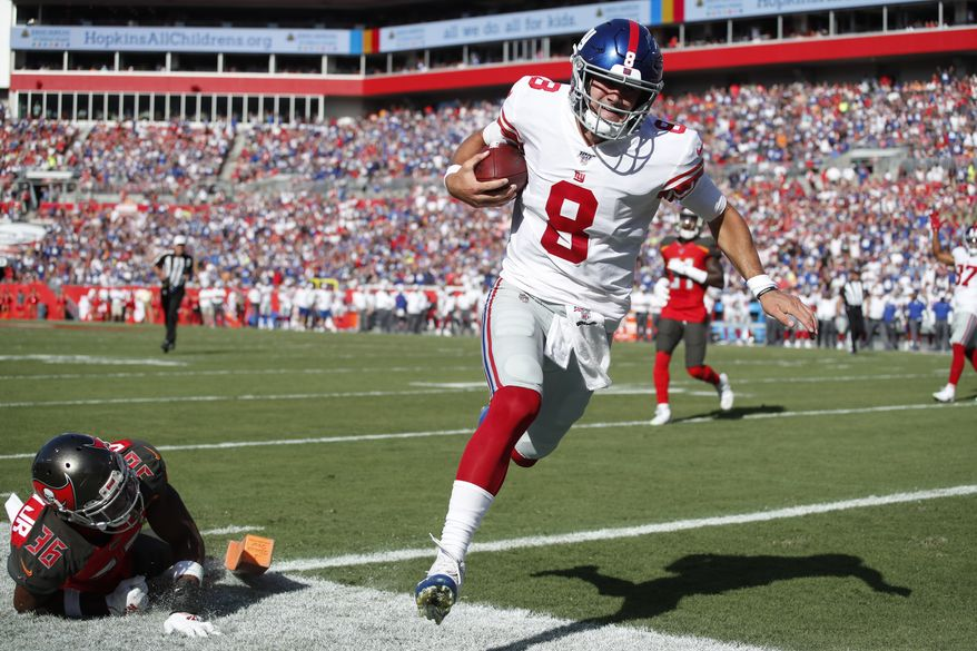 New York Giants quarterback Daniel Jones (8) runs in for a touchdown avoiding Tampa Bay Buccaneers cornerback M.J. Stewart (36) during an NFL football game, Sunday, Sept. 22, 2019, in Tampa, Fla. The Giants won the game 32-31. (Jeff Haynes/AP Images for Panini) ** FILE **