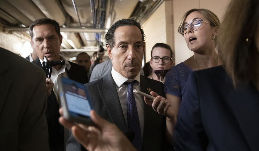 Rep. Jamie Raskin, D-Md., a member of the House Judiciary Committee, is questioned by reporters after Speaker of the House Nancy Pelosi, D-Calif., met with the Democratic Caucus and decided to launch a formal impeachment inquiry against President Donald Trump, at the Capitol in Washington, Tuesday, Sept. 24, 2019. (AP Photo/J. Scott Applewhite) **FILE**