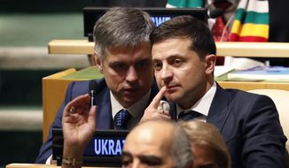 Ukrainian President Volodymyr Zelensky listens to speakers at the 74th session of the United Nations General Assembly at U.N. headquarters Tuesday, Sept. 24, 2019. (AP Photo/Seth Wenig)