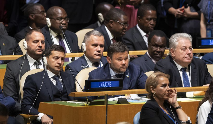 Delegates from the Ukraine listens as U.S. President Donald Trump addresses the 74th session of the United Nations General Assembly at U.N. headquarters Tuesday, Sept. 24, 2019. (AP Photo/Mary Altaffer)