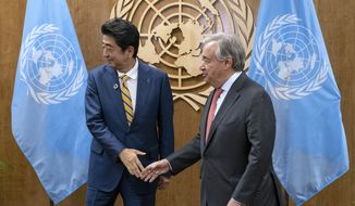 Japanese Prime Minister Shinzo Abe, left, meets with United Nations Secretary General Antonio Guterres during the 74th session of the United Nations General Assembly, at U.N. headquarters, Tuesday, Sept. 24, 2019. (AP Photo/Craig Ruttle)
