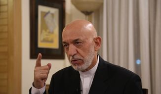 Former President Hamid Karzai speaks during an interview in Kabul, Afghanistan, Tuesday, Sept. 24, 2019. (AP Photo/Rahmat Gul)