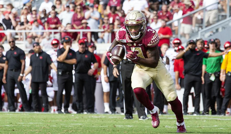 FILE - In this Sept. 21, 2019, file photo, Florida State running back Cam Akers (3) heads toward the goal line in the first half of an NCAA college football game against Louisville, in Tallahassee, Fla. Akers is coming off a grinding 112 yards and three touchdowns in a victory against Louisville. North Carolina State comes to Tallahassee on Saturday, (AP Photo/Mark Wallheiser, File)