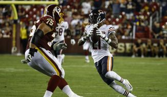 Chicago Bears strong safety Ha Ha Clinton-Dix (21) runs with his interception in front of Washington Redskins offensive guard Brandon Scherff (75) during the second half of an NFL football game Monday, Sept. 23, 2019, in Landover, Md. (AP Photo/Patrick Semansky) **FILE**