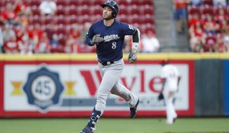 Milwaukee Brewers' Ryan Braun runs the bases after hitting a solo home run during the second inning of the team's baseball game against the Cincinnati Reds, Tuesday, Sept. 24, 2019, in Cincinnati. (AP Photo/John Minchillo)