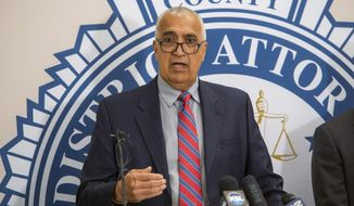 District Attorney Sim Gill announces an effort to reduce penalties for minor drug offenses during a news conference at the Salt Lake County District Attorney's Building, Tuesday, Sept. 24, 2019. Thousands of people in Utah will be able to clear their old criminal records after a mass reduction of criminal charges by the top prosecutor in its largest county, a step that's among the first of its kind in the country. (Rick Egan/The Salt Lake Tribune via AP)