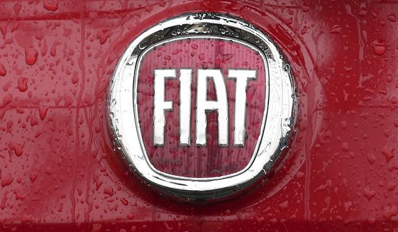 FILE - In this Thursday, Jan. 2, 2014 file photo, a Fiat logo pictured on a car in Milan, Italy. A top European court has ruled that automaker Fiat will have to pay up to 30 million euros, 33 million US dollars, in back taxes to Luxembourg. The Luxembourg-based General Court ruled Tuesday, Sept. 24, 2019, that the EU's anti-trust regulator, the European Commission, had acted correctly in 2015 when it ordered Fiat Chrysler Finance Europe to return the tax break. (AP Photo/Antonio Calanni, File)